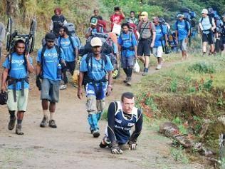 Inspiration: Paralympic champion Kurt Fearnley crawling the Kokoda trail.