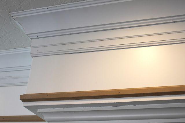 Soffit makeover - 3 pieces of trim - crown, a baseboard hung upside down and pin mold at the bottom of the soffit.  Beautiful!