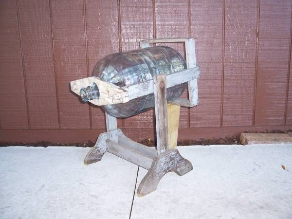 antique 5 gallon water bottle pouring stand would be useful for off grid
