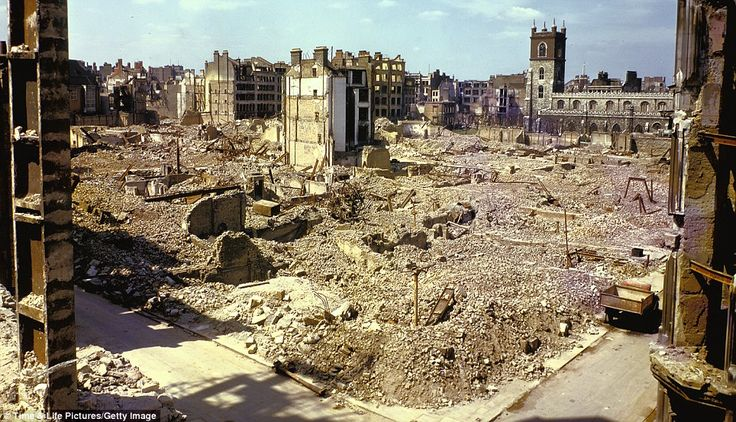 The random nature of the bombing is clearly demonstrated here as a church, right, remains untouched while a vast swathe of buildings close by were reduced to rubble