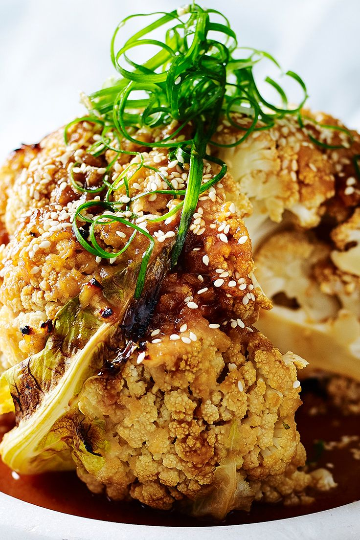 Whether you're following a meat-free diet or are just looking for creative ways to up your vegie intake, try this delicious whole roasted cauliflower. It's the perfect vegan alternative to a Christmas centrepiece. Find this recipe and more like it in The Australian Women's Weekly's 'Eat Well Live Well' cookbook.