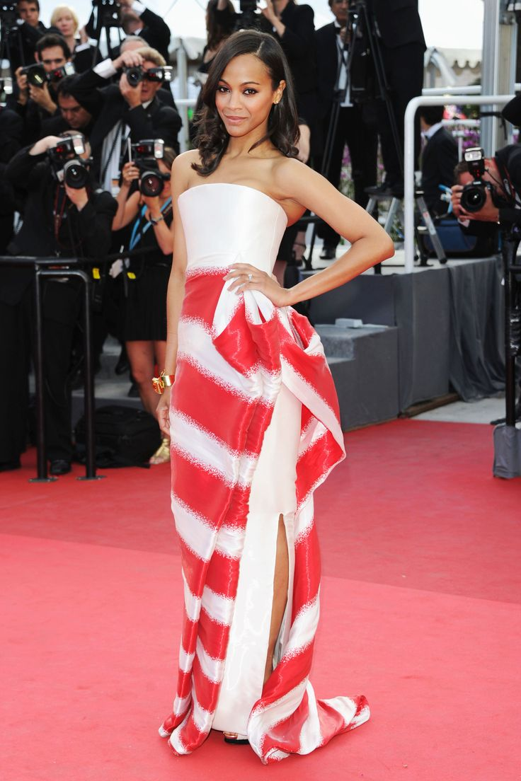 What: Armani Prive Where: Cannes Film Festival in 2011 Why: Saldana brought the drama (and a little American spirit?) to Cannes in this silk organza gown.   - HarpersBAZAAR.com
