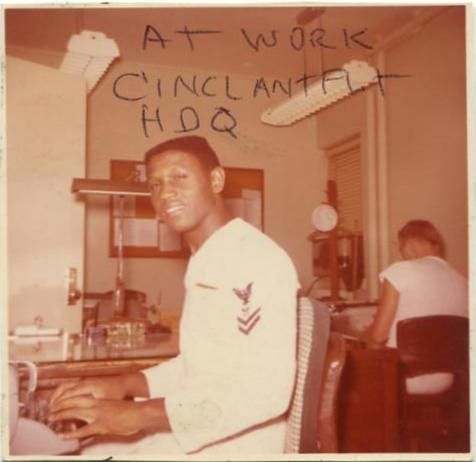 Color snapshot of Lawrence E. Allen typing on the typewriter at his desk at Commander In Chief, U.S. Atlantic Fleet (CINCLANFLT) Headquarters, at the U.S. Naval Base in Norfolk, Virginia. Allen is pictured in his U.S. Navy white uniform (1950s).  From Lawrence E. Allen Sr. Papers, CLDW 23, Cold War Papers, Military Collection, State Archives of North Carolina, Raleigh, N.C.