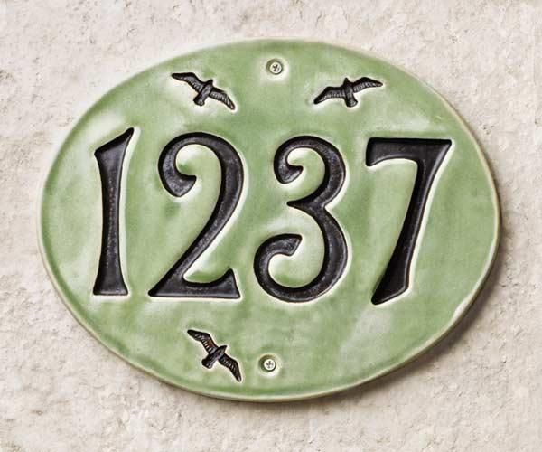 These handcrafted oval house-number signs offer a twist on ordinary block numbers; screw holes make them easy to hang. Cost: about $90 as shown; Ravenstone Tiles. | Photo: Andrew McCaul | thisoldhouse.com