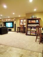 basement with craft area and game storage