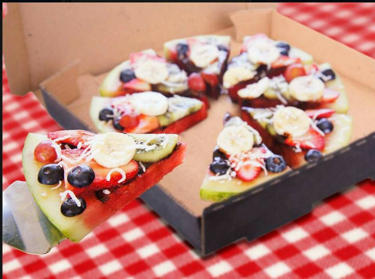 Fruit pizza! Watermelon base with Banana, Kiwi Fruit, Blueberry and Strawberry with grated White choc on top YUM