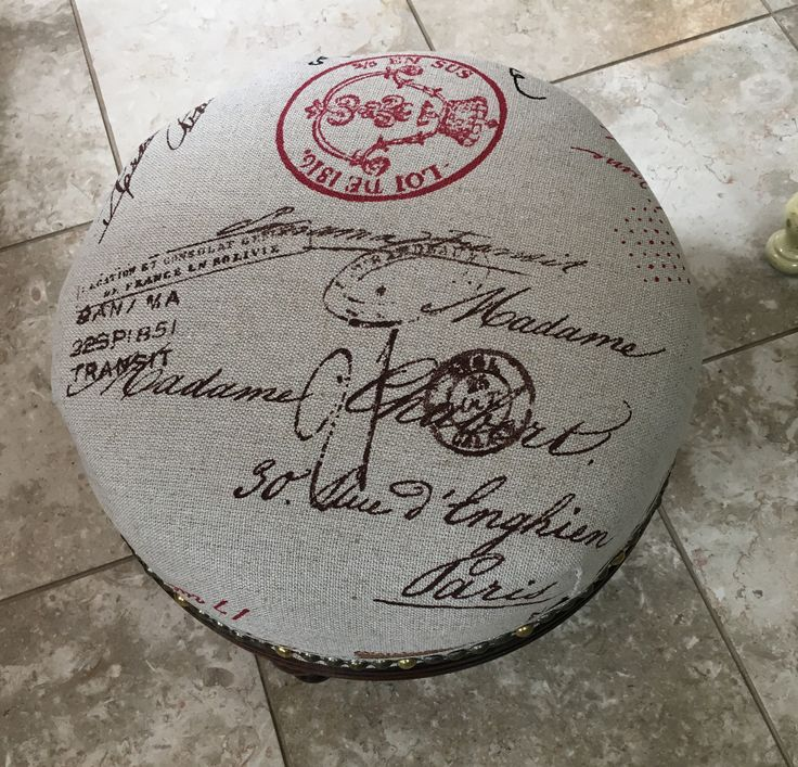 Nice vintage footstool I re-upholstered. Great faux french fabric.