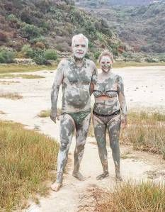 I love this photo of two folks who have covered themselves with mud