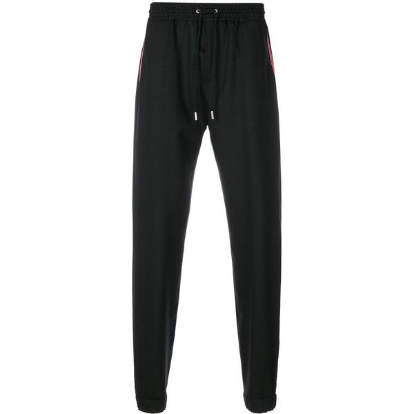 Givenchy stars and stripe panel tapered trousers ($755) ❤ liked on Polyvore featuring men's fashion, men's clothing, men's pants, men's casual pants, black, mens drawstring pants, mens stretch waist pants, mens elastic waistband pants, mens tuxedo stripe pants and mens tapered pants