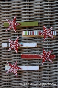 clothes pins and scrapbook paper. string a cord and pin christmas cards to it