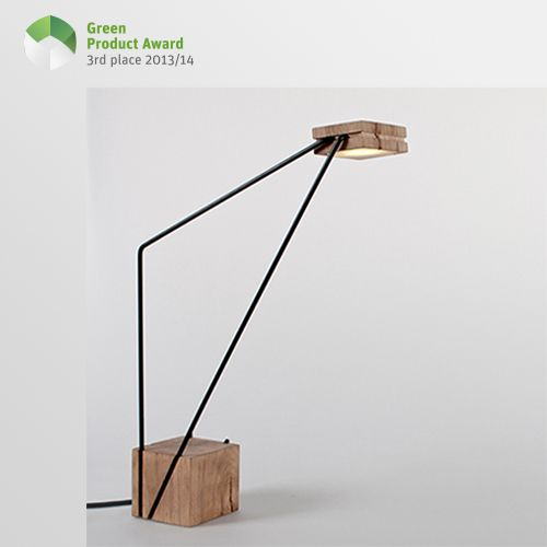 3rd place Newcomers Green Product Award, category Home Accessories: Tra-e is a wooden lamp made from blends of wood sawmill, which are connected by metal rods. They can be divided into four components that can be plugged into each other and combined in various ways. This allows the lamp to be used as a working, table and room light. The two metal rods serve not only as light arms, but also as a conductor for the light. Therefore, no additional cables are needed.