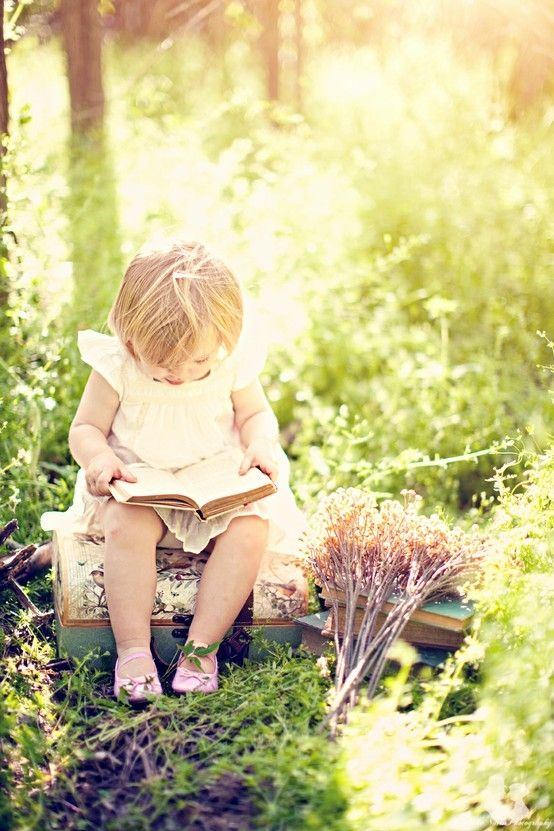 Little girl reading.
