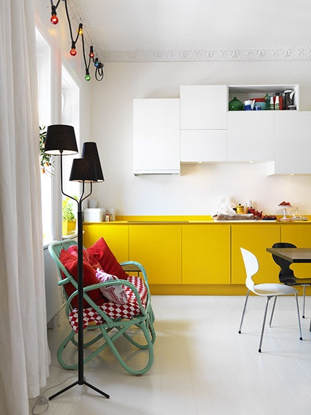 fun yellow kitchen with asymmetric upper cabinets