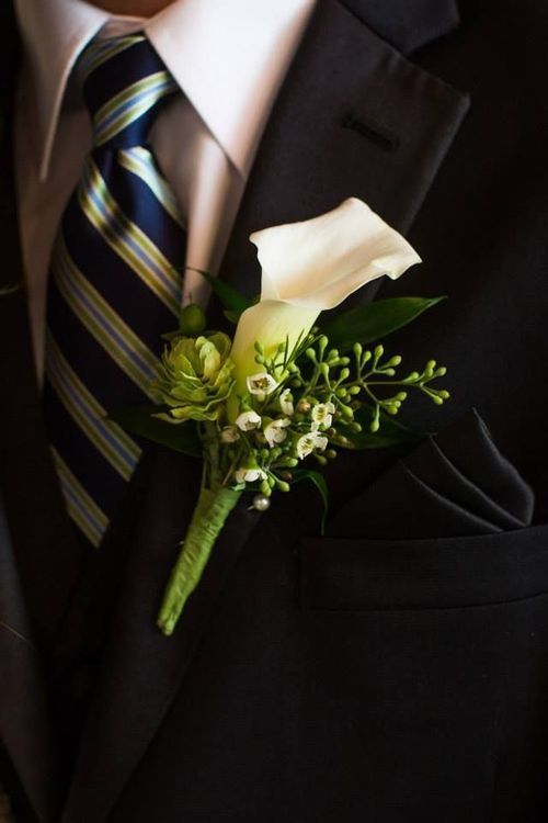 great dark image of a wedding boutonniere using hops