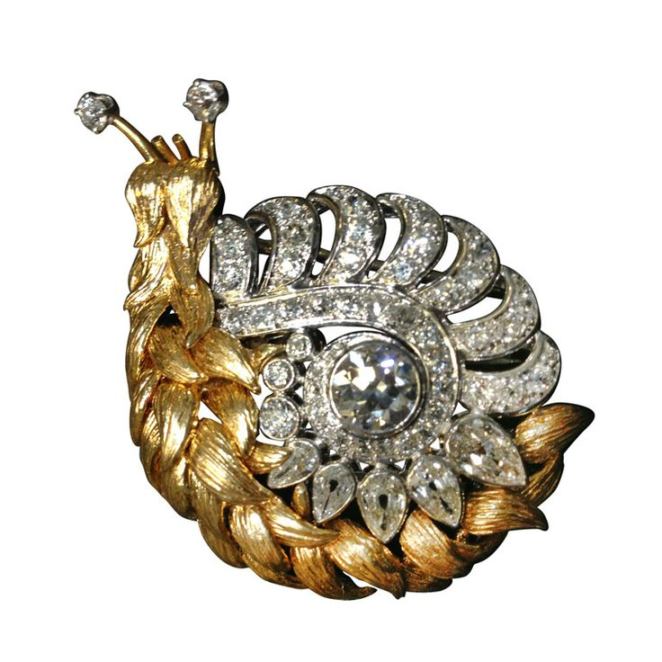 David WebbThis quirky and creative Snail brooch is exactly the type of statement piece you would expect from David Webb, the stark combination of the 18k yellow gold body and Diamond encrusted Platinum shell are sure to delight. Snails have been a long re-occurring theme in David Webbâ??s designs and this is by far one of the most inventive takes on the snail from the David Webb house.Circa 1960s