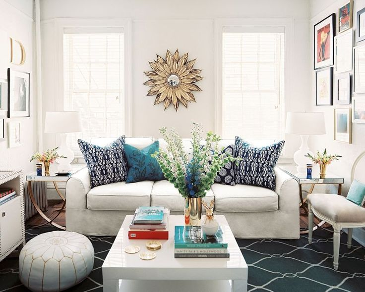 Surya's blue Fallon rug gels well with the Moroccan inspired accessories in this room.: White Sofas, Sunburst Mirror, Blue, Color, Small Living Rooms, Coff Tables, Small Spaces Living, Rugs, White Wall
