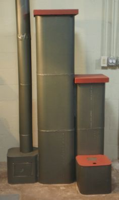 """4"""" Dragon Heater Castle Build. Small inexpensive masonry heater built with chimney flues and painted with high temperature paint. Moss Metallic Green and Mojave Red."""