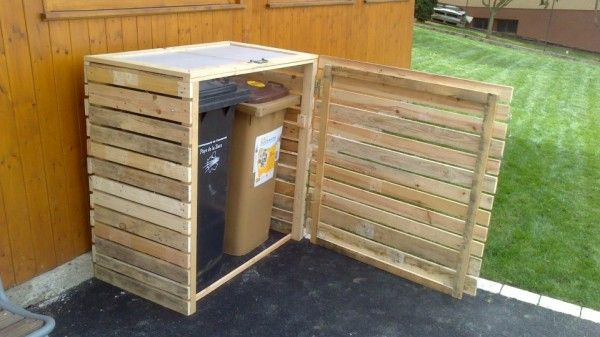Pallet garbage bins shelter. Both the top and side of this wood bin lift up/swing out to allow easy access to the trash cans. Clever way to hide the trash barrels! For more pallet reuse ideas, DIY tutorials, and design inspiration, go to http://pinterest.com/wineinajug/passion-for-pallets/