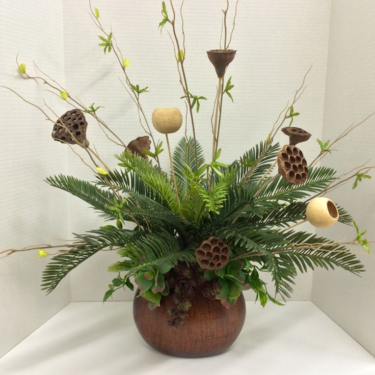 Faux Greenery 2015 Tabletop: large bush cycas, succulents, foliage bundles, spray kiwi, dry bell cups and lotus pods on oval peanut shape retro wood vase. Original design and arrangement by http://nfmdesign.synthasite.com/