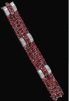 Ruby and diamond bracelet by Van Cleef & Arpels, circa 1940. Set with oval and circular-cut rubies, highlighted with arches set with baguette and circular-cut diamonds, length approximately 180mm, signed Van Cleef & Arpels and numbered, French assay marks. Via Sotheby's.