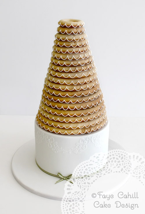 Single Kransekake on a tier of cake....this is so lovely!!!! By Faye Cahill Cake Design
