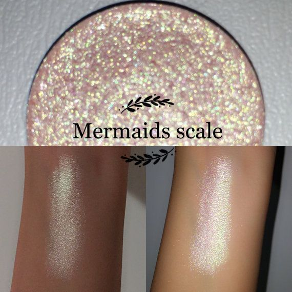 Welcome to Enchanted lustre! Where all items are hand made and made to order ❤️  26mm pan only:  Mermaids scale - my personal favourite shade which can also be used as a highlighter! A duochrome soft salmon pink with a green silver reflect. Safe for use around eyes, cheeks and even a lip frosting! All ingredients in our eyeshadows are vegan (except red/rust colours), cruelty free, paraben free, talc free, highly pigmented, natural and blendable. Ingredients - Mica, propyl alcohol, coconut…