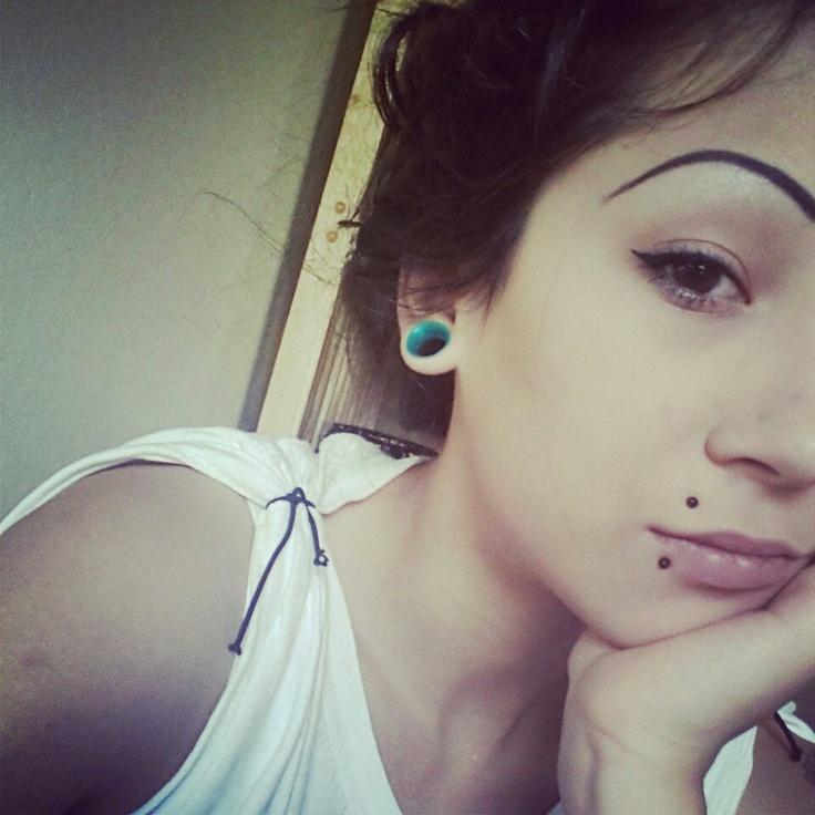 Selfie girl with lip piercing