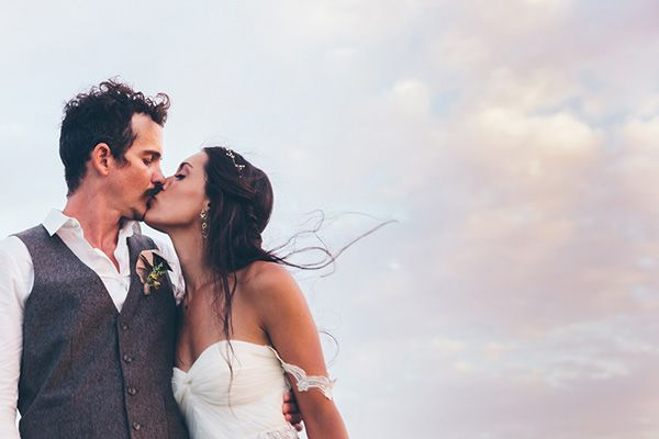 Love this romantic bride and groom photo. The beach backdrop is perfect! | http://www.weddingpartyapp.com/blog/2014/10/20/rustic-nicaragua-destination-wedding-parker-young-photography/