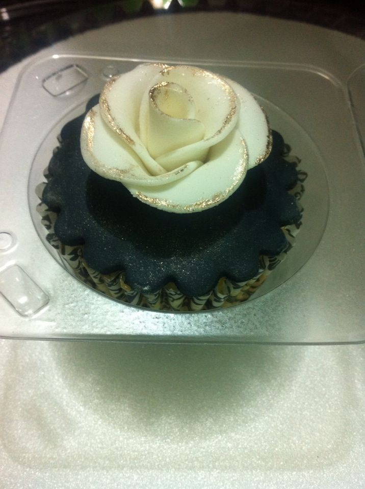 Cupcake de naranja con decoración en fondant