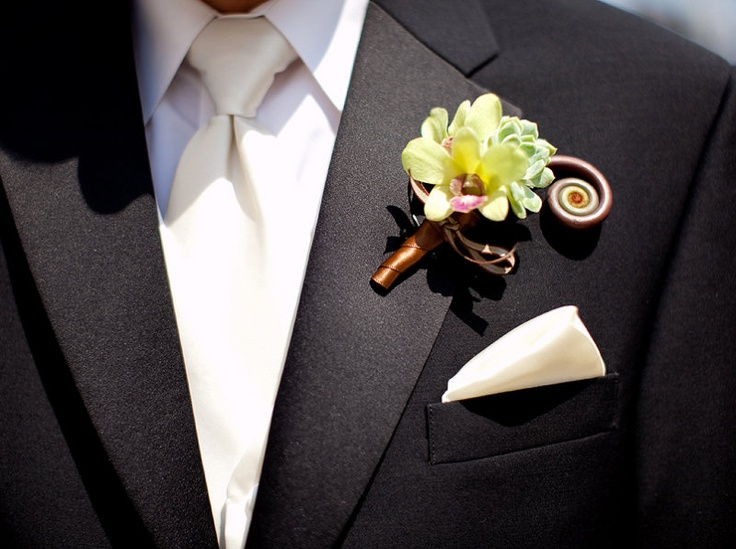 Boutonniere. Dendrobium Orchid. Succulent. Fiddlehead Fern. Green and Brown. Vale of Enna Flowers. Secondprint Production Photography. Chicago Wedding.