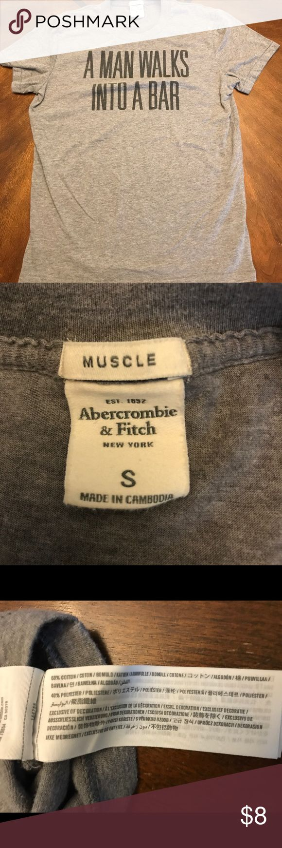 Abercrombie and Fitch Man Walks Into a Bar Small This is a super soft, great condition tshirt from Abercrombie & Fitch. It's gray and says A Man Walks Into A Bar. AF makes great shirts and this is no exception. It's a Small and the fit is muscle. It's a cotton and polyester blend. Abercrombie & Fitch Shirts Tees - Short Sleeve