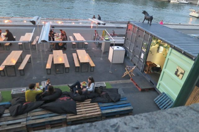 A little restaurant built out of a shipping container on the Sienne in Paris. The lounging area is giant pillows scattered over pallets. Sipping champagne is customary...