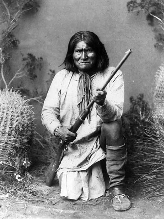 photos of american indian warriors | Photograph of Geronimo kneeling with his rifle, taken in 1887 by Ben ...