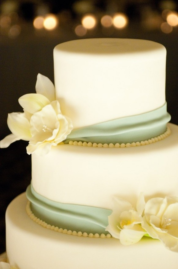 I love the simple mint color ribbons with the cream flowers.