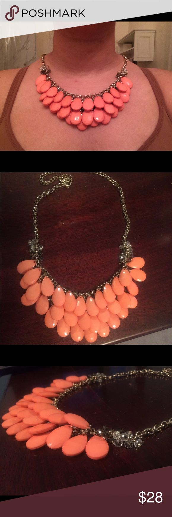 Francesca's coral/peach necklace This is a statement piece. It has lovely coral teardrop beads, and then more transparent grey and clear beads on either side of the coral. The gold colored chain is adjustable, so you can change it based on the neckline of whatever garment you're wearing! The color pops with almost anything and will make you the center of attention.   Like new, only worn once to a gala. (I wore a jungle green dress). Francesca's Collections Jewelry Necklaces