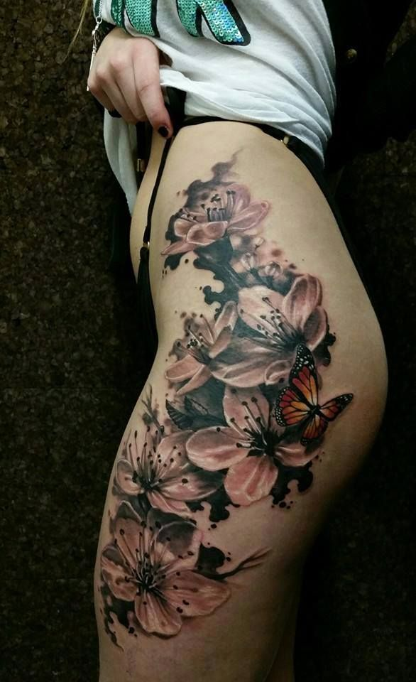 Chronic Ink Tattoo - Toronto Tattoo Cherry blossoms and butterfly thigh  tattoo done by Csaba.