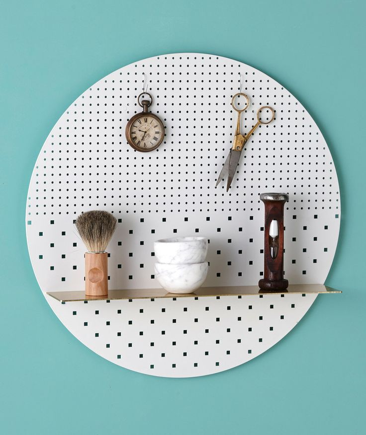 A more clean, modern alternative to pegboard. Wonder if one could experiment more with the shape, maybe keep it plain steel for more of the rustic look (and simplicity of manufacture)