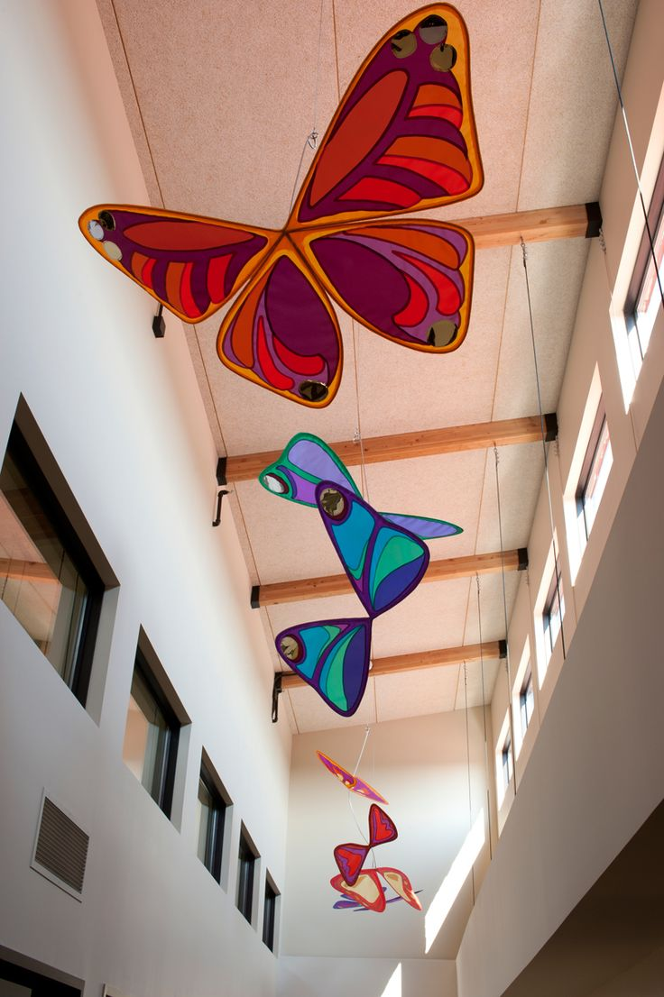 Large-scale butterfly display created for Happy Hands Education Center in Broken Arrow, Oklahoma. Colorful hanging mobile kinetic art by Banner Art Studio.