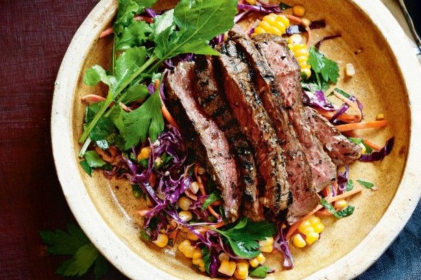 Brighten up your dinner with some jerk steaks and a side of freshly made cornslaw.
