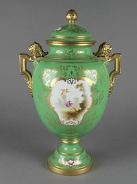 """Lot No 19 A Coalport green ground 2 handled vase and cover with a panel of exotic birds opposed by a panel of spring flowers with lion handles 14"""", sold for £140"""