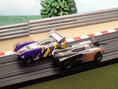 New arrival for sale! Micro Scalextric ... See it here http://www.actionslotracing.co.uk/products/micro-scalextric-pair-of-1-64-cars-black-purple-thunder-bugs?utm_campaign=social_autopilot&utm_source=pin&utm_medium=pin