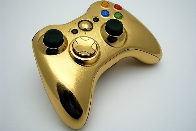 Xbox 360 gold plated controller. Sold separately. Gold played Xbox 360 not included.
