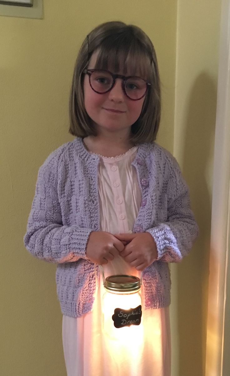 My daughter dressed up as Sophie from BFG for her school project. Very simple to create the look - cardigan and nightie purchased at local car boot sale, specs are reading glasses bought for 1.99 with lenses popped out, and 'Sophie's Dream' is a Mason jar lined with tissue paper and battery operated LED fairy lights.