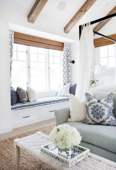 I like these color and texture combinations. The rustic woven rug and the blue and white of the couch and pillows. - J