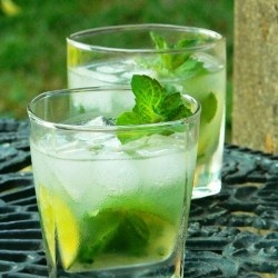 Mojito: 10 fresh mint leaves, 1/2 lime, cut into 4 wedges, 2 Tbsp white sugar, 1 cup ice cubes, 1-1/2 oz. white rum, 1/2 cup club soda. Place mint leaves and 1 lime wedge into sturdy glass and muddle. Add 2 more lime wedges and sugar, and muddle again. Do not strain mixture. Fill glass almost to the top with ice. Pour rum over the ice, and fill glass with carbonated water. Stir, taste, and add more sugar if desired. Garnish with remaining lime wedge.