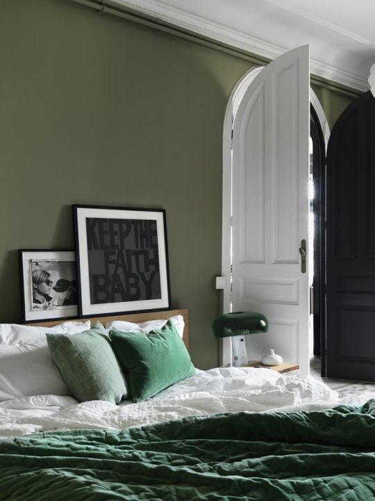 i like how there are several muted hues of one colour in this room, offset by black and white - apartment therapy