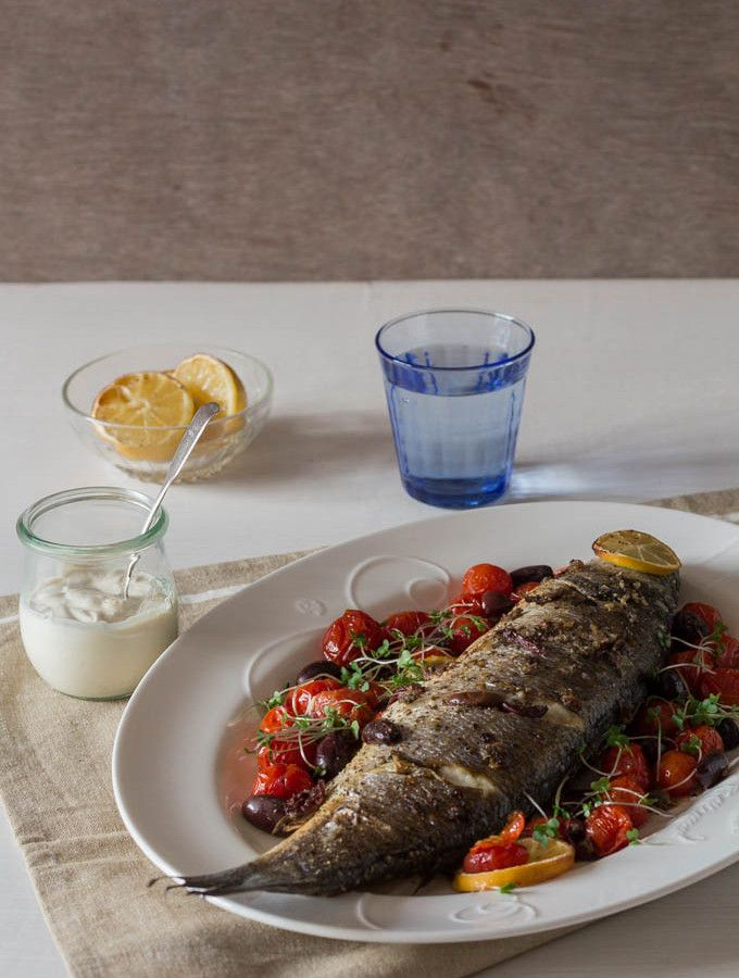 Whole Baked Sea Bass with Olives and Tahini Sauce - Give yourself a taste of Greece with this very EASY recipe. | Recipes From A Pantry