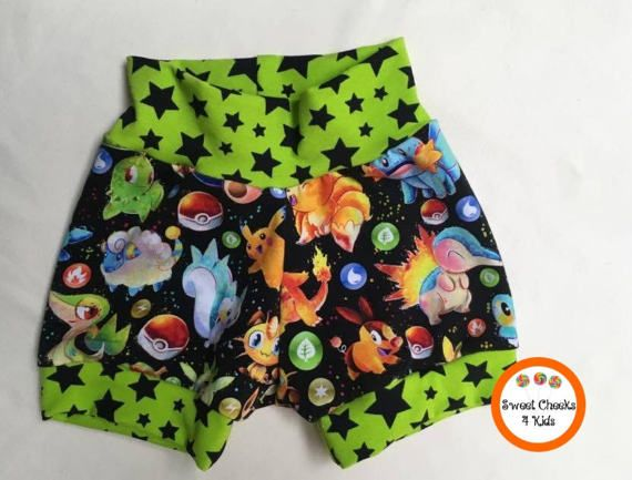For the gamers, geeks and nerds with children, I have found the perfect fabric! Any kids fortunate enough to own a set of these adorable shorts will be the best dressed on the block. They are designed with a pokemon theme and contrasting green with black or white stars. The fabric is a very soft and beautiful cotton spandex.    Pokemon Clothing, Trendy Baby Clothing, Pokemon Shorts for Kids, Pokemon Gift Kids, Pokemon Birthday Gift, Trendy Kids Clothes, Hipster Kids