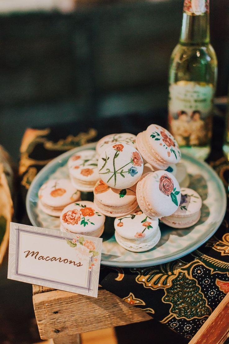 Macarons painted with dainty floral motifs in orange, red and pink //  We hope you had a wonderful weekend, Wedding Scoopers! Here are some teaser photos from the Peranakan styled shoot we did in KL, Malaysia, that included this stunning wedding gown and the prettiest hand-painted macarons! We can't wait to share the whole set with you very soon!