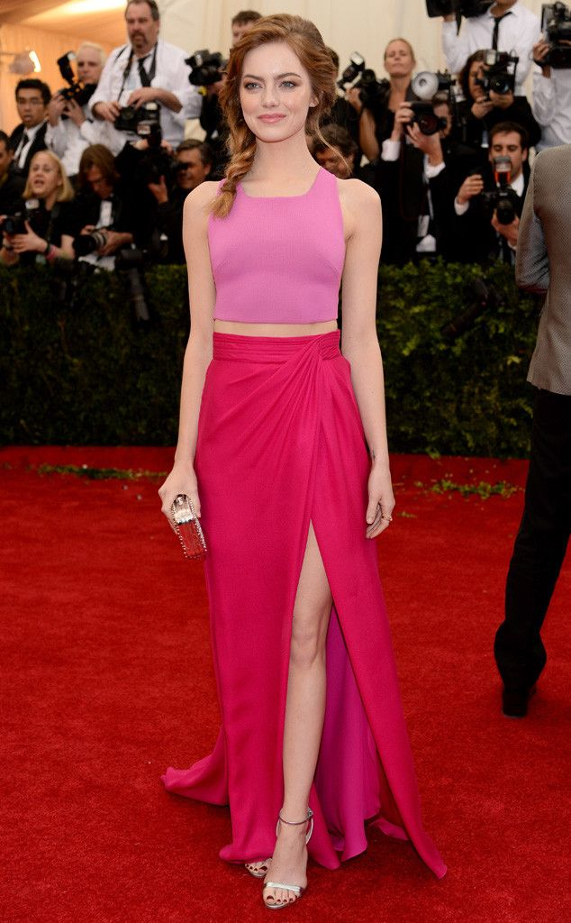Emma Stone is pretty in pink at the Met Gala in this sexy crop top and skirt combo by Thakoon.